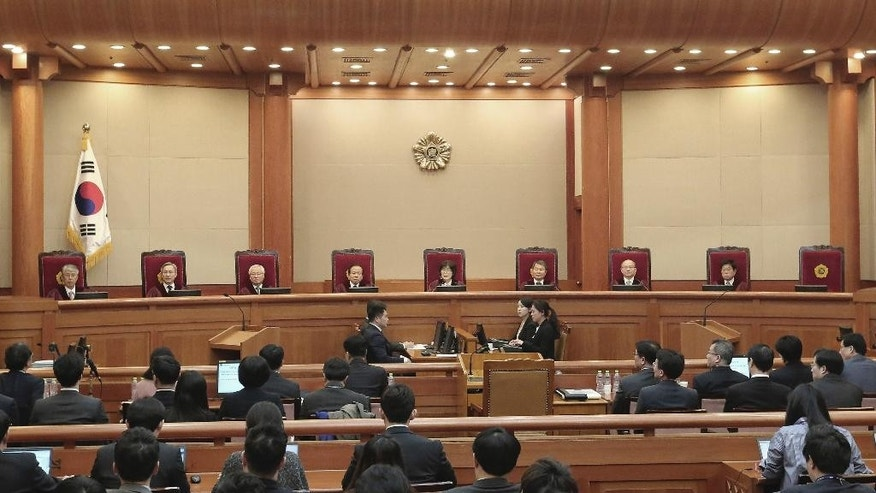 Judges of the Constitutional Court sit during the final hearing on whether to confirm the impeachment of President Park Geun-hye at the Court in Seoul, South Korea, Monday, Feb. 27, 2017. A special investigation team is wrapping up its probe into a huge scandal involving impeached Park after the country's acting leader refused to extend its investigation past a Tuesday deadline. (AP Photo/Ahn Young-joon, Pool)
