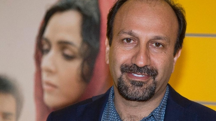 "FILE -- In this Oct. 10, 2016 file photo, Iranian director Asghar Farhadi poses for a photo during the premiere of his film, ""The Salesman, in Paris. Iran's top diplomat has congratulated director Asghar Farhadi for winning the Oscar in the best foreign language category with his film ""the Salesman."" Mohammad Javad Zarif saw the prize as a move against President Donald Trump's effort to bar U.S. entry to citizens from seven majority Muslim countries, including Iran. Zarif tweeted: ""Proud of Cast and Crew of ""The Salesman"" for Oscar and stance against #MuslimBan. Iranians have represented culture and civilization for millennia."" (AP Photo/Michel Euler, File)"