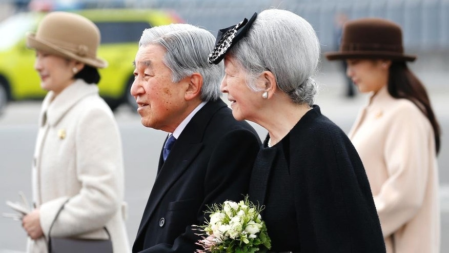 Japan's Emperor Akihito and Empress Michiko walk before boarding their airplane to leave for Vietnam at the Haneda International Airport in Tokyo, Tuesday, Feb. 28, 2017. (AP Photo/Shizuo Kambayashi)