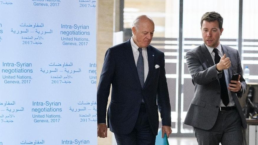 UN Special Envoy for Syria Staffan de Mistura, left, arrives for a meeting during Syria peace talks in Geneva, Switzerland, Monday, Feb. 27, 2017. (Fabrice Coffrini/Pool Photo via AP)