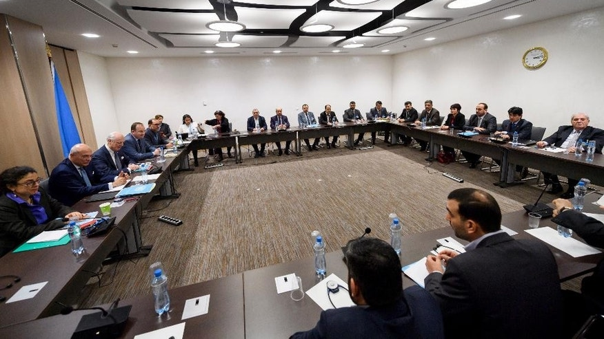 General view at the start of a meeting between UN Special Envoy for Syria Staffan de Mistura, third left, and Syria's main opposition delegation during Syria peace talks in Geneva, Switzerland, Monday, Feb. 27, 2017. (Fabrice Coffrini/Pool Photo via AP)