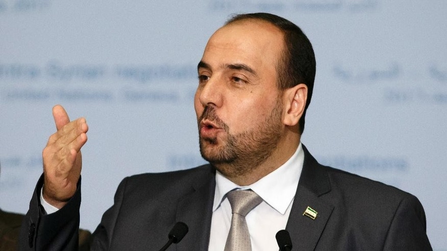 Syria's main opposition High Negotiations Committee, HNC, leader Nasr al-Hariri speaks during a press conference, after a round of negotiation between the HNC and the UN Special Envoy for Syria Staffan de Mistura at the European headquarters of the United Nations in Geneva, Switzerland, Monday, Feb. 27, 2017. (Salvatore Di Nolfi/Keystone via AP)