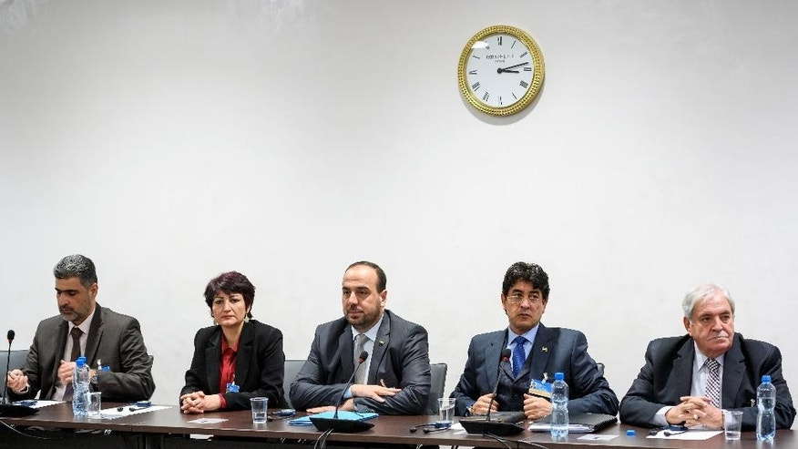 Syria's main opposition delegation with High Negotiations Committee, HNC, leader Nasr al-Hariri, center, attend a meeting with United Nations special envoy for Syria Staffan de Mistura during Syria peace talks in Geneva, Switzerland, Monday, Feb. 27, 2017. (Fabrice CoffriniPool Photo via AP)