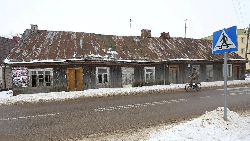 In this photo taken Feb. 13, 2017, a cyclist rides in Kobylin-Borzymy, eastern Poland. Months before Britain voted to leave the European Union or the United States elected President Donald Trump, Poles booted out their own political establishment, a pro-business and pro-European party, Civic Platform, which had governed for eight years. (AP Photo/Czarek Sokolowski)