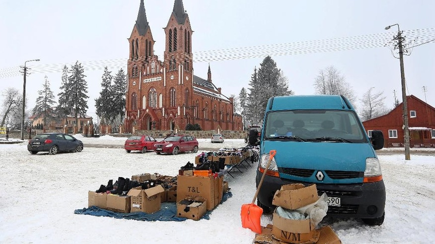 This photo taken Feb. 13, 2017 shows used items offered for sale in front of the parish church of Saint Stanislaus in Kobylin-Borzymy, eastern Poland. Months before Britain voted to leave the European Union or the United States elected President Donald Trump, Poles booted out their own political establishment, a pro-business and pro-European party, Civic Platform, which had governed for eight years. (AP Photo/Czarek Sokolowski)