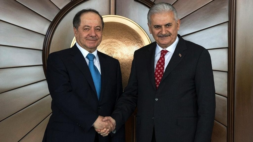 Turkey's Prime Minister Binali Yildirim, right, shakes hands with Iraqi Kurdish leader Massoud Barzani, in Ankara, Turkey, Monday, Feb. 27, 2017. Barzani, on a working visit to Turkey and according to the government, Turkey's relations with Iraq and the Iraqi Kurdish regional government, the fight against terrorism and regional developments will be addressed. (Prime Minister's Press Service, Pool Photo via AP)