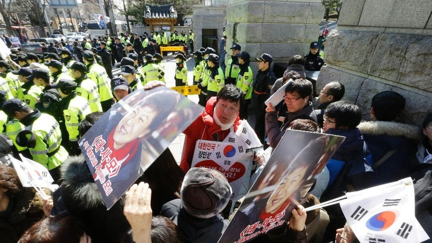 Supporters of impeached South Korean President Park Geun-hye stage a rally opposing her impeachment as the Constitutional Court holds its final hearing in the impeachment trial of Park in front of the court in Seoul, South Korea, Monday, Feb. 27, 2017. A special investigation team is wrapping up its probe into a huge scandal involving Park after the country's acting leader refused to extend its investigation past a Tuesday deadline. (AP Photo/Ahn Young-joon)