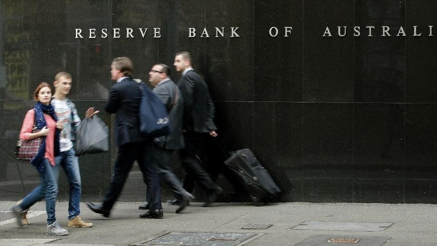 FILE - In this Tuesday, Aug. 6, 2013, file photo, people walk past the Reserve Bank of Australia in Sydney, Australia. Australia's economy expanded at a faster-than-expected 1.1 percent annual pace in the final three months of last year, as resurgent coal and iron ore prices helped the country avoid recession according to Australian Bureau of Statistics figures released on Wednesday. (AP Photo/Rob Griffith, File)