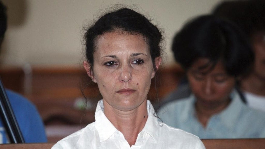 Australian national Sara Connor, center, sits in a court room during her trial in Bali, Indonesia, Tuesday, Feb. 28 2017. Indonesian prosecutors want jail sentences of 8 years for Connor and British man David Taylor for the murder of an Indonesian police officer in August 2016. (AP Photo/Firdia Lisnawati)