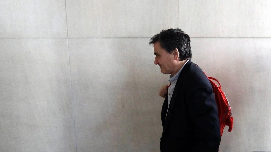 Greek Finance Minister Euclid Tsakalotos arrives for talks with bailout inspectors about Greece's progress program in Athens, on Tuesday, Feb. 28, 2017. Last week, Greece agreed to legislate new reforms to come into effect in 2019, but said these will be fiscally neutral: for every euro's worth of new burdens on the Greek taxpayer, an equal amount of relief will be granted. (AP Photo/Thanassis Stavrakis)