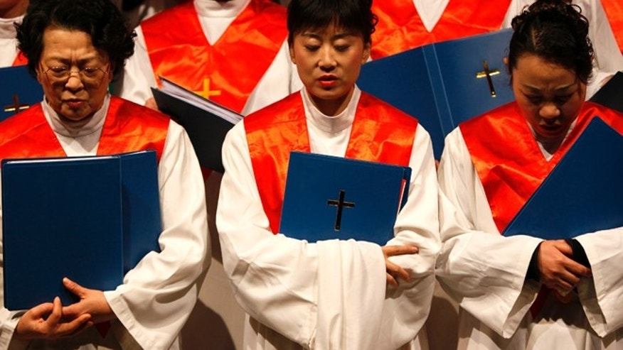 Protestants from the Nanjing Christian Church sing carols during a Christmas function in Nanjing, Jiangsu province, December 19, 2009.