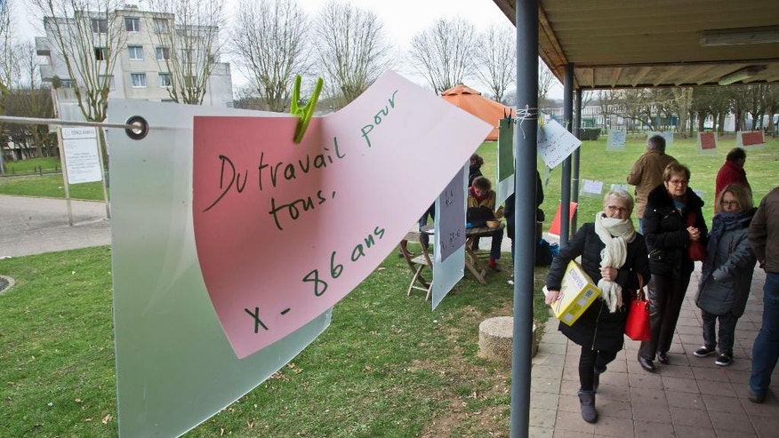 "A poster reads ""Work for All"" on a paper hanging in Crepy-en-Valois, 50 kilometers (31 miles) north of Paris, Sunday, Feb. 27, 2017. A handwritten sign invited market-goers in this down-and-out town to make their voices heard ahead of a pivotal presidential election. The working-class town of Crepy is fertile ground for candidates on the extremes of the spectrum after years of economic decline. (AP Photo/Michel Euler)"