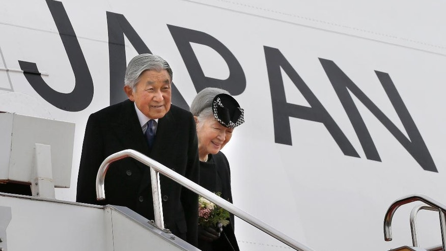 Japan's Emperor Akihito and Empress Michiko smile as they leave for Vietnam at the Haneda International Airport in Tokyo, Tuesday, Feb. 28, 2017. (AP Photo/Shizuo Kambayashi)