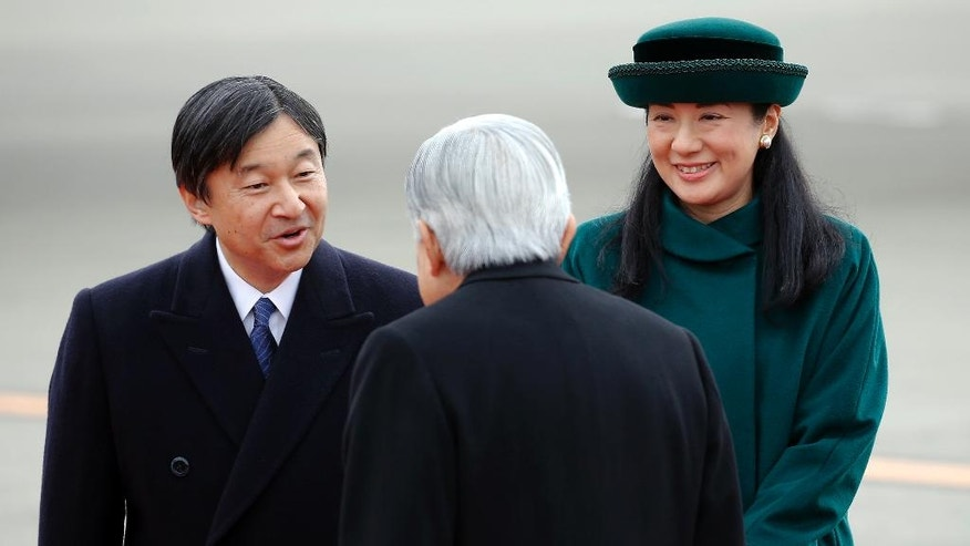 Japan's Emperor Akihito, center, greets Crown Prince Naruhito and Crown Princess Masako as he prepares to leave for Vietnam at Haneda International Airport in Tokyo, Tuesday, Feb. 28, 2017. (AP Photo/Shizuo Kambayashi)