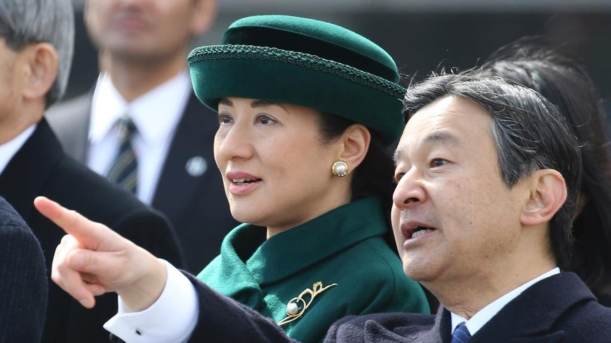 Japan's Crown Prince Naruhito and Crown Princess Masako talks as Emperor Akihito and Empress Michiko depart for Vietnam from the Haneda International Airport in Tokyo, Tuesday, Feb. 28, 2017. (AP Photo/Shizuo Kambayashi)