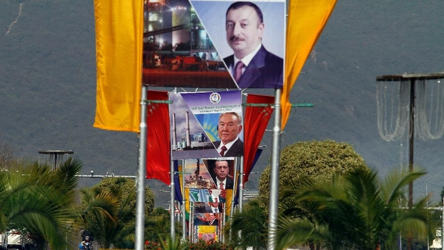 Billboards showing presidents of Azerbiajan, Kazakhstan and Turkey on a main highway to welcome them in Islamabad, Pakistan, Tuesday, Feb. 28, 2017. Pakistan will host representatives from 10 countries of the Economic Cooperation Organization on Wednesday to finalize a plan for expanding trade and prosperity in the region. (AP Photo/Anjum Naveed)