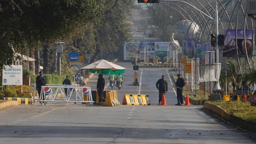 Pakistani police officers stand guard at a barricaded road leading to the venue of the Economic Cooperation Organization summit in Islamabad, Pakistan, Wednesday, March 1, 2017. Pakistani Prime Minister Nawaz Sharif has opened a key economic summit aimed at improving trade ties amid unprecedented security. Islamabad is hosting 13th Economic Cooperation Organization summit consisting 10 countries to finalize a plan for expanding trade and prosperity among member nations. (AP Photo/Anjum Naveed)