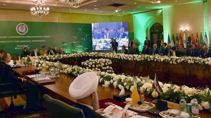In this photo released by Associated Press of Pakistan, leaders and representatives of the member states of the 10-nation Economic Cooperation Organization (ECO) attend the 13th ECO summit in Islamabad, Pakistan, Wednesday, March 1, 2017. Participants in the regional economic summit agreed Wednesday to collectively fight the challenge of terrorism and push for greater collaboration in the areas of trade, energy and infrastructure development. (Associated Press of Pakistan via AP)
