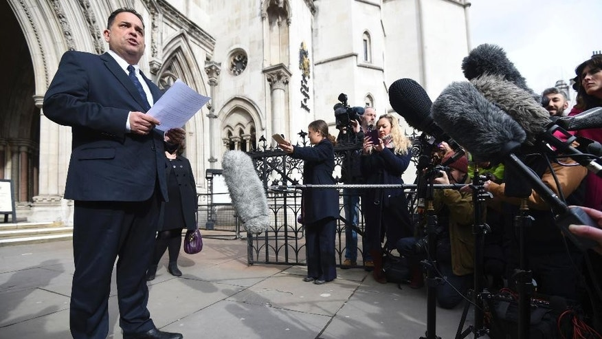 "Managing Director of travel company Tui Nick Longman  reads a statement  abouta deadly  gun attack in Tunisia outside the Royal Courts of Justice in London Tuesday Feb. 28, 2017 . The coroner said  the Tunisian police response to a deadly gun attack on the beach resort of Sousse was ""at best shambolic, at worst cowardly."" Judge Nicholas Lorraine-Smith is delivering his findings Tuesday at an inquest into the deaths of 30 British tourists killed in the June 2015 attack at the five-star Riu Imperial Marhaba hotel.  (Kirsty O'Connor/PA via AP)"