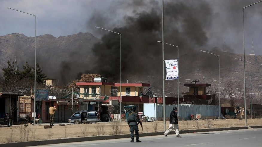 Smoke rises from a district police headquarters after a suicide bombing in Kabul, Afghanistan, Wednesday, March 1, 2017. An Afghan official says that a suicide car bomber attacked at the gates of a police station in the western part of the capital, Kabul. (AP Photo/ Rahmat Gul)
