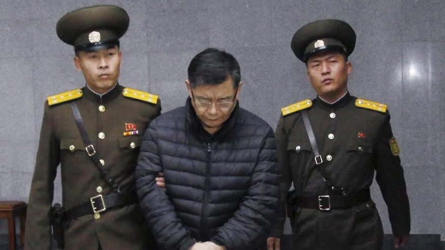 FILE - In this Dec. 16, 2015, file photo, Canadian pastor Hyeon Soo Lim, center, is escorted to his sentencing in Pyongyang, North Korea. Swedish Ambassador Torkel Stiernlof said in an email to The Associated Press on Wednesday, March 1, 2017, the Canadian pastor serving a life sentence in North Korea has been allowed to meet with the ambassador in Pyongyang and telephone his family. Stiernlof says he met Lim for 40 minutes last week. He said they discussed Lim's health and other matters, but refused to comment further. (AP Photo/Jon Chol Jin)