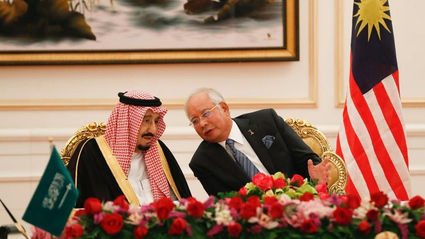 Saudi King Salman, left, listens to Malaysian Prime Minister Najib Razak during the MOU signing ceremony in Putrajaya, Malaysia, Monday, Feb. 27, 2017. Salman arrived in Malaysia on Sunday to kick off a multi-nation tour aimed at boosting economic ties with Asia. (AP Photo/Vincent Thian)