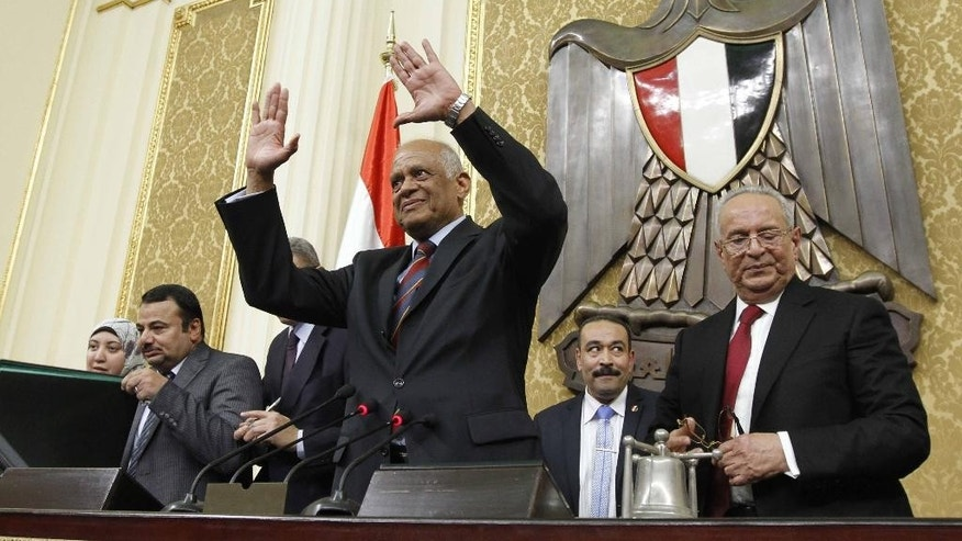 "FILE -- In this Jan. 10, 2016 file photo, law professor Ali Abdel-Al waves after he was elected Speaker of Egypt's new parliament, in Cairo, Egypt. Egypt's flagship state newspaper, Al-Ahram, in  the Wednesday, Mar. 1, 2017, edition, accused Abdel-Al of making ""inappropriate"" comments and borderline abuse of authority, a rare and potentially damaging spat between two of the country's oldest institutions. Separately Abdel-Al has said this week he planned to sue the editor of an independent daily for defamation of the legislature, a 596-seat chamber packed with government supporters. (Mohamed El Maymony, El -Shorouk Newspaper via AP, File)"