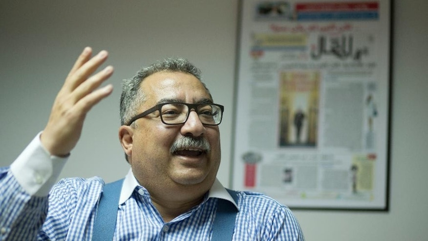"In this Nov. 10, 2016 photo, Ibrahim Eissa, chief editor of the independent Al-Maqal, speaks during an interview with The Associated Press, at his office in Cairo, Egypt. Egypt's flagship state newspaper, Al-Ahram, in the Wednesday, Mar. 1, 2017, edition, accused Parliament Speaker Ali Abdel-Al of making ""inappropriate"" comments and borderline abuse of authority, a rare and potentially damaging spat between two of the country's oldest institutions. Separately Abdel-Al has said this week he planned to sue Eissa for defamation of the legislature, a 596-seat chamber packed with government supporters. (AP Photo/Amr Nabil)"