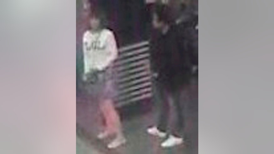 FILE - This file image provided by Star TV of closed circuit television footage from Feb. 13, 2017, shows Vietnamese Doan Thi Huong, left, at Kuala Lumpur International Airport in Sepang, Malaysia, who police say was arrested in connection with the death of Kim Jong Nam, the half brother of North Korean leader Kim Jong Un. Because of a grainy security camera photo that went viral, she is now known to many as the LOL assassin. But as Doan Thi Huong arrived at a courthouse to be formally charged with the murder of Kim Jong Nam, she had a very different look _ tear-filled eyes and a bulletproof vest. (Star TV via AP, File)