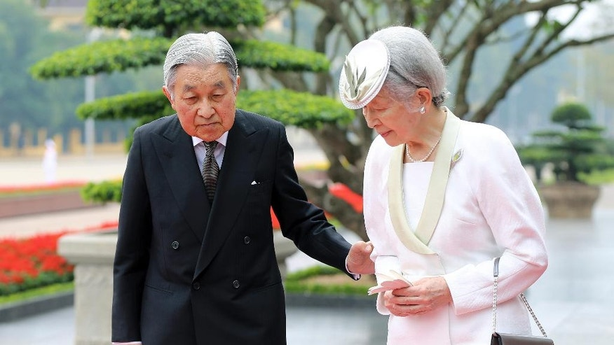 Japan's Emperor Akihito walks with Empress Michiko during a wreath laying ceremony at the mausoleum of the late Vietnamese President Ho Chi Minh in Hanoi, Vietnam, Wednesday, March 1, 2017. (Luong Thai Linh/Pool Photo via AP)