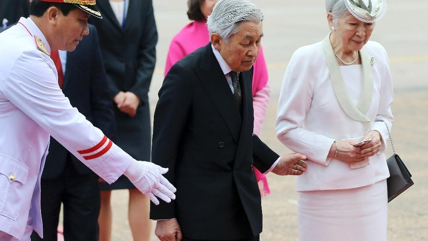 Japan's Emperor Akihito, center, and Empress Michiko, right, are shown the way during a wreath laying ceremony at the mausoleum of the late Vietnamese President Ho Chi Minh in Hanoi, Vietnam, Wednesday, March 1, 2017. (Luong Thai Linh/Pool Photo via AP)