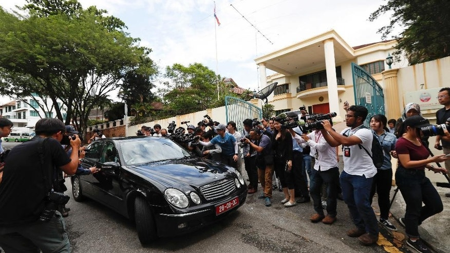 Media film and photograph a North Korean diplomatic vehicle leaving the North Korean embassy in Kuala Lumpur, Malaysia, Thursday, March 2, 2017. Malaysia is scrapping visa-free entry for North Koreans traveling into the country, the state news agency said Thursday in the latest fallout from a deadly nerve agent attack at Kuala Lumpur airport. (AP Photo/Vincent Thian)
