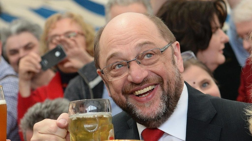 Designated Social Democratic Party chairman and top candidate in the upcoming general elections, former president of the European parliament Martin Schulz, attends  the party's Ash Wednesday meeting in Vilshofen, Germany,  Wednesday, March 1, 2017.  (Angelika Warmuth/dpa via AP)
