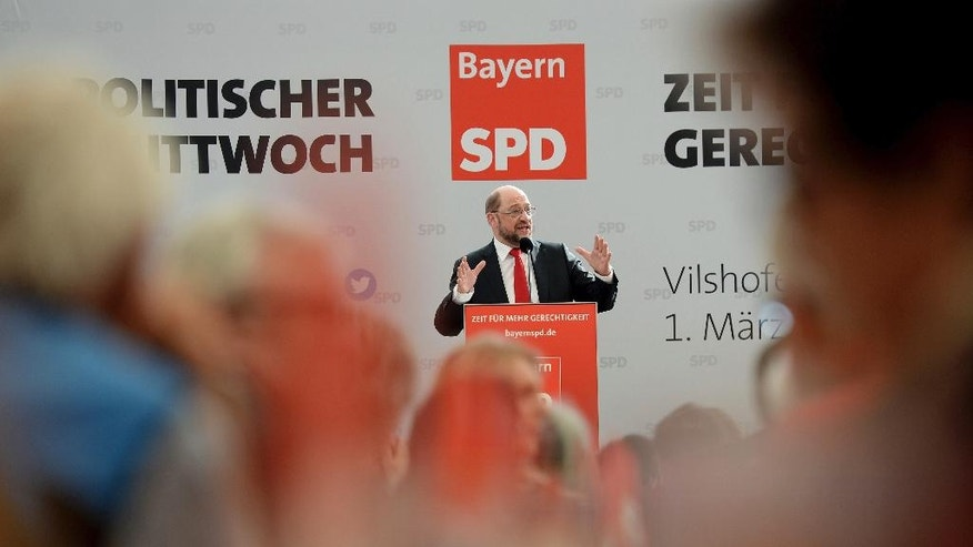 Designated Social Democratic Party chairman and top candidate in the upcoming general elections, former president of the European parliament Martin Schulz, speaks at the party's Ash Wednesday meeting in Vilshofen, Germany,  Wednesday, March 1, 2017.  (Angelika Warmuth/dpa via AP)