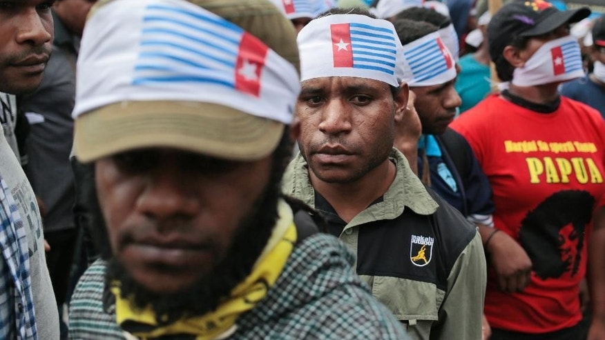 "FILE - In this Thursday, Dec. 1, 2016, file photo, West Papuan protesters wear headbands of banned ""Morning Star"" flag during a rally calling for the remote region's independence, in Jakarta, Indonesia. Seven Pacific island nations have called for a U.N. investigation into allegations of human rights abuses in Indonesia's West Papua and Papua provinces, where a separatist movement has simmered for decades. (AP Photo/Dita Alangkara, File)"