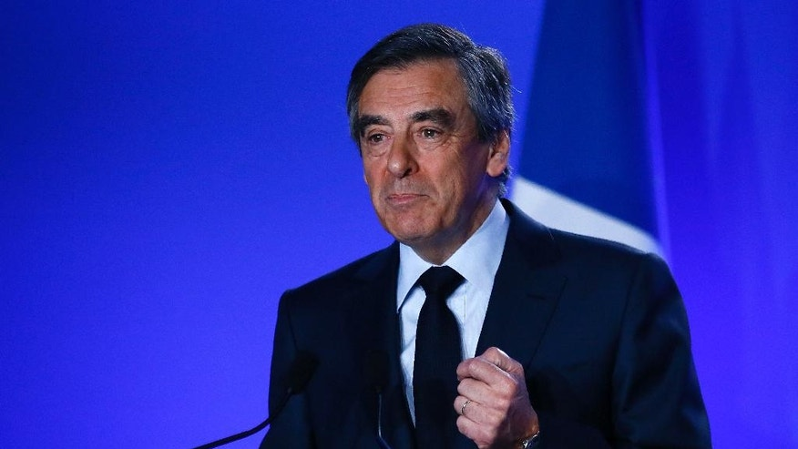 Conservative presidential candidate Francois Fillon delivers his speech at his campaign headquarters in Paris, Wednesday, March 1, 2017. Fillon is refusing to quit the race despite receiving a summons Wednesday to face charges for alleged fake parliamentary jobs for his family. (AP Photo/Francois Mori)