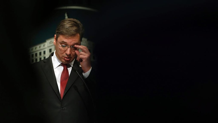 In this photo taken Feb. 12, 2015, Serbia's Prime Minister Aleksandar Vucic gestures during a press conference, in Belgrade, Serbia. Serbia's parliament speaker has set April 2, 2017 as the date for the country's presidential election when a populist leader is to face a challenge from fractured opposition. Serbia's current populist Prime Minister Aleksandar Vucic is considered a clear favorite to win the presidency. (AP Photo/Darko Vojinovic)