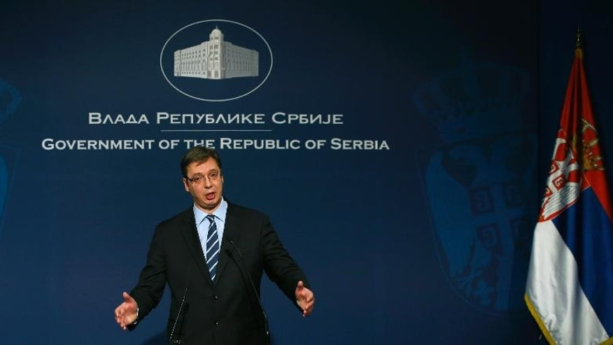 In this photo taken Dec. 13, 2016, Serbia's Prime Minister Aleksandar Vucic gestures during a press conference, in Belgrade, Serbia. Serbia's parliament speaker has set April 2, 2017 as the date for the country's presidential election when a populist leader is to face a challenge from fractured opposition. Serbia's current populist Prime Minister Aleksandar Vucic is considered a clear favorite to win the presidency. (AP Photo/Darko Vojinovic)