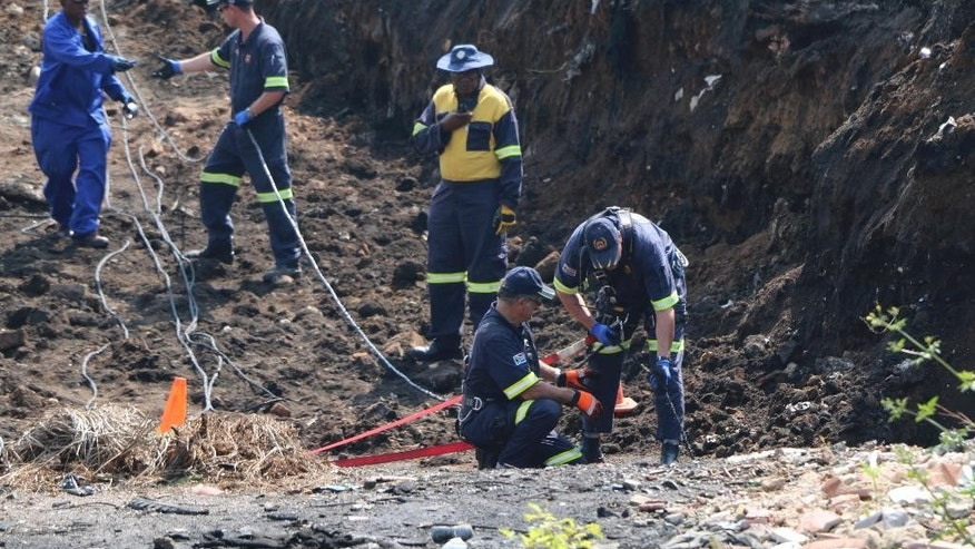 In this photo taken Wednesday March 1, 2017, mine rescue workers operate at a shaft where a boy has been missing since the weekend in Boksburg, South Africa. Rescue teams in South Africa have asked the military to help find a 5-year-old boy who fell into a disused mine shaft last weekend. Military officials arrived at the scene Thursday after fruitless efforts to locate Richard Thole, who disappeared into the shaft while playing Saturday near his home. Emergency responders say the shaft is 140 meters (460 feet) deep and contains potentially lethal gas as well as acidic water. (AP Photo/Renee Graham)