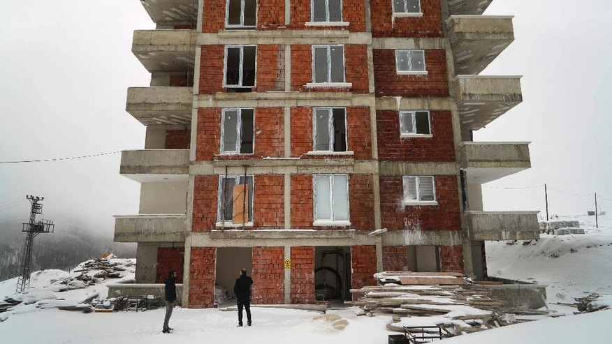 In this Thursday, Feb. 16, 2017 photo, a building consisting of flats, some already sold to clients from Saudi Arabia, Dubai, Bahrain, Abu Dhabi, in Turkey's Black Sea region's city of Samsun. At least four projects to lure visitors from the Gulf region and Arab nations are underway along Turkey's more traditional and conservative Black Sea coastline, where _ unlike Turkey's more popular Mediterranean and Aegean coasts _ residents and visitors opt for full body covering swimsuits and where bars selling alcohol are few and far between.(AP Photo/Neyran Elden)