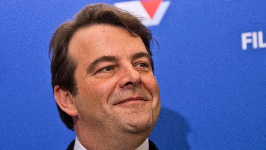 FILE - In this file photo taken on Thursday, Dec. 15, 2016, Thierry Solere, the conservative presidential candidate Francois Fillon's spokesman, smiles during a media conference in Paris. French conservative Francois Fillon's presidential bid took another blow Friday March 3, 2017 after his spokesman Thierry Solere resigned from his campaign team. (AP Photo/Michel Euler, File)