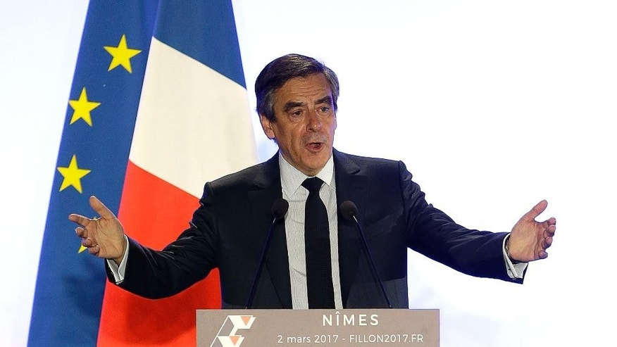 Conservative presidential candidate Francois Fillon delivers his speech in Nimes, Thursday, March 2, 2017. Fillon is refusing to quit the race despite receiving a summons Wednesday to face charges for alleged fake parliamentary jobs for his family. (AP Photo/Claude Paris)