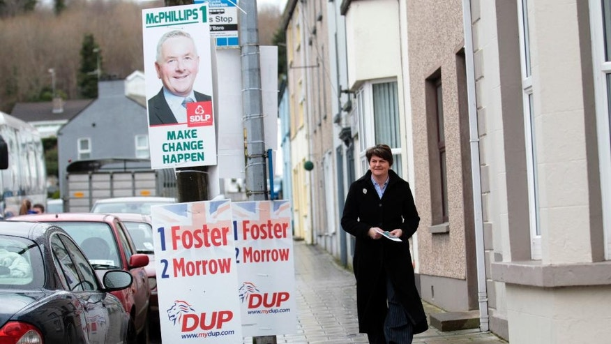 Democratic Unionist Party leader Arlene Foster arrives to cast her vote at a polling station in Brookeborough, Northern Ireland, Thursday, March 2, 2017. Voting has begun Thursday in the British province of Northern Ireland to elect a new Stormont Assembly after the power-sharing government collapsed in January. (AP Photo/Peter Morrison)