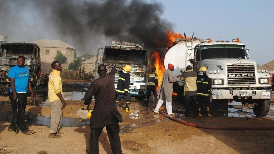 Firefighters try to contain a fire following a suicide attack at petrol tankers in Maiduguri, Nigeria, Friday, March. 3, 2017. Three suicide bombers set ablaze three fuel tankers in the center of Nigeria's northeastern city of Maiduguri before dawn Friday, officials said, just days before a planned visit by the U.N. Security Council. (AP Photo/Jossy Ola)