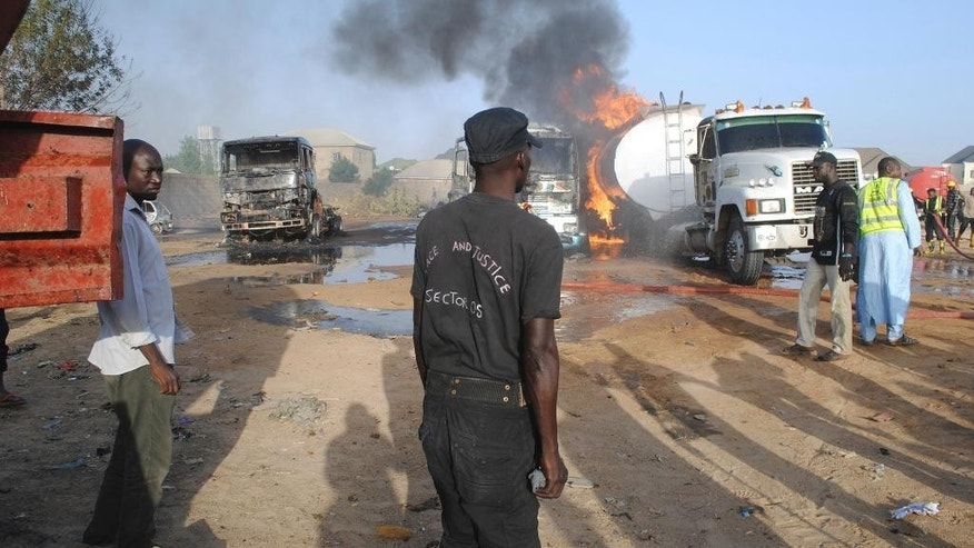 Firefighters try to contain a fire following a suicide attack at a petrol tankers in Maiduguri, Nigeria, Friday, March 3, 2017. Three suicide bombers set ablaze three fuel tankers in the center of Nigeria's northeastern city of Maiduguri before dawn Friday, officials said, just days before a planned visit by the U.N. Security Council. (AP Photo/Jossy Ola)