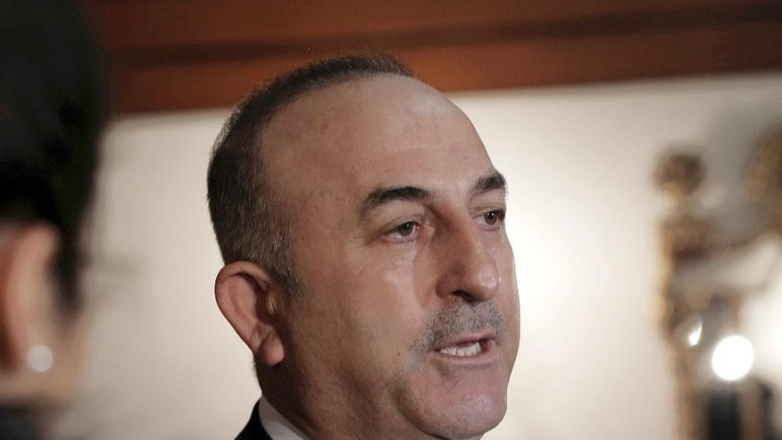 "Turkey's Foreign Minister Mevlut Cavusoglu speaks to the media in Ankara, Turkey, Friday, March 3, 2017. Cavusoglu says a ""deep state"" in Germany is working to prevent Turkish leaders from campaigning to get Turks living in Germany to vote 'yes' in an upcoming referendum to increase the president's powers. Cavusoglu made the comments Friday, a day after local authorities in southwest Germany withdrew a permission for the Turkish justice minister to use a venue for a political rally. (AP Photo/Burhan Ozbilici)"