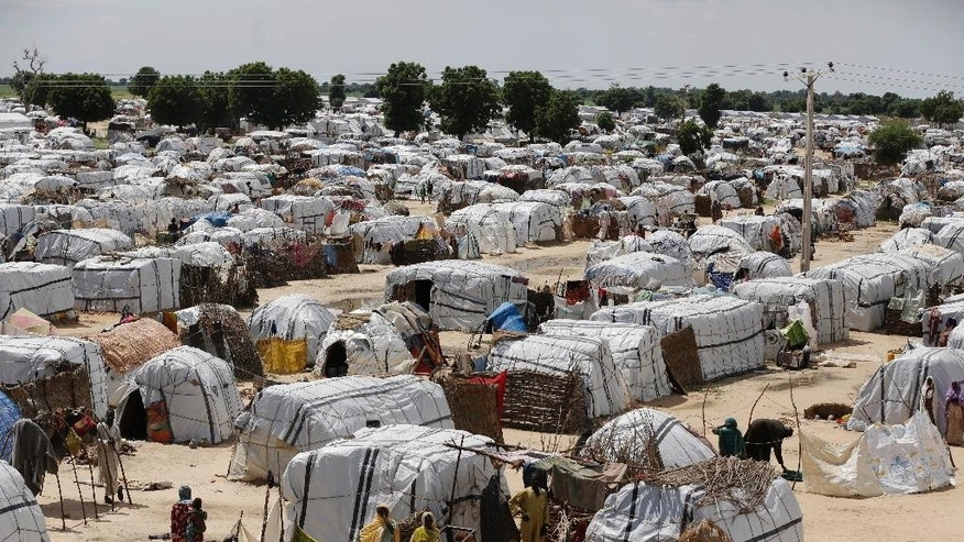 FILE- In this Sunday Aug. 28, 2016 file photo a top view of one of the biggest camp for people displaced by Islamist Extremist in Maiduguri, Nigeria.The U.N. Security Council on Friday, March. 3, 2017 kicked off a visit to spotlight Africa's worst humanitarian crisis as millions face hunger amid the Boko Haram insurgency in Nigeria and the Lake Chad region. ( AP Photo/Sunday Alamba, File)