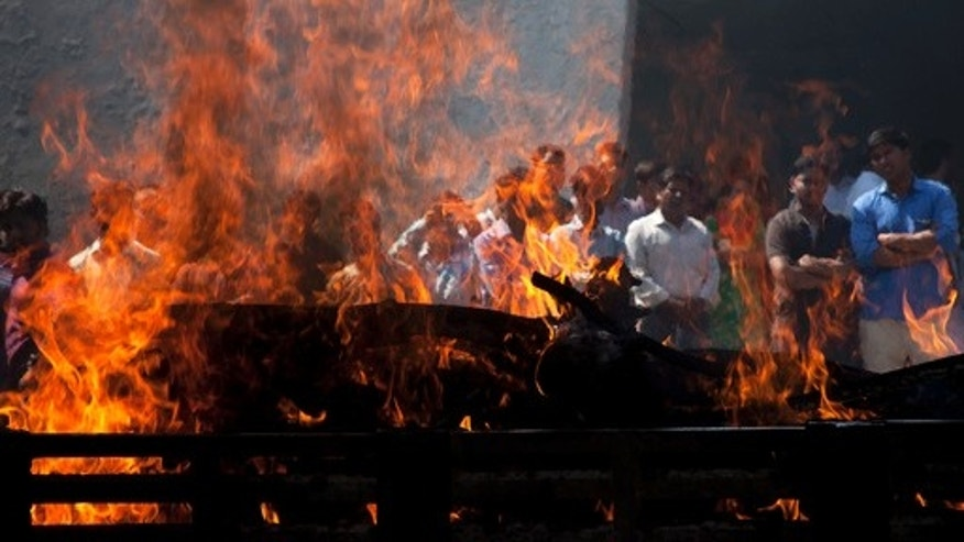 Cremation at a funeral pyre in India.