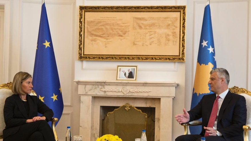 Kosovo President Hashim Thaci, right, meets EU foreign policy chief Federica Mogherini, in capital Pristina, Kosovo on Saturday, March 4, 2017. Mogherini is on a tour of the Balkans trying to reassure the region that the EU remains open for enlargement despite crises in the 28-nation bloc.(AP Photo/Visar Kryeziu)