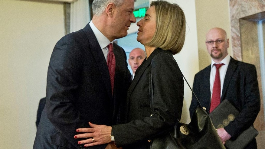 Kosovo President Hashim Thaci, left, welcomes EU foreign policy chief Federica Mogherini, in capital Pristina, Kosovo on Saturday, March 4, 2017. Mogherini is on a tour of the Balkans trying to reassure the region that the EU remains open for enlargement despite crises in the 28-nation bloc. (AP Photo/Visar Kryeziu)